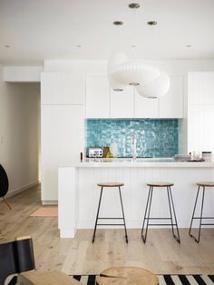 good kitchen layout but those tiles and pendants are not my thing...Sydney beachside apartment at Tamarama Beach