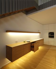 under-cabinet lighting | Custom made haning kitchen element by Holzrausch.