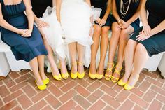 Navy blue bridesmaid dresses with bright yellow shoes