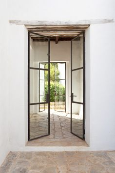 Belgian family rescued an Ibiza finca from ruins, restoring it into a magical getaway rental - Belgian Pearls Exterior Design, Interior And Exterior, Casa Petra, Architecture Design, Steel Doors And Windows, Old Country Houses, Iron Doors, Metal Doors, Iron Gates