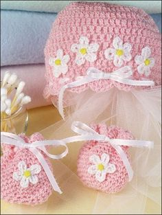 This quick and easy hat and mittens set is decorated with cheery flowers for a finishing touch!Size: Includes Newborn through 3 months. Made with medium (worsted) weight yarn and size F/5/3.75mm hook.Skill Level: Beginner