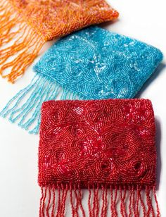 Beaded cross-body purse with fringe.  Love the style but can do without the fringe.