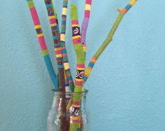 Driftwood sticks hand painted by LivingLikeLexie on Etsy