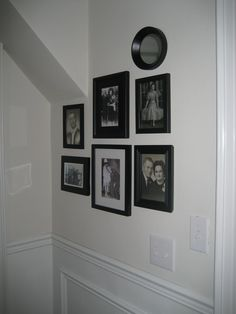 love the idea of having old family photos displayed