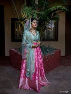 The bride looks stunning in the beautiful sky blue lehenga paired with a rani pink lehenga skirt. Also, the dupatta looks simple and blend well with the whole outfit. This lehenga is apt for you if you're looking for some offbeat lehenga designs. Royal Blue Lehenga, Orange Lehenga, Pink Lehenga, Bridal Lehenga, Banarasi Lehenga, Lehenga Skirt, Indian Lehenga, Lehenga Blouse, Indian Gowns