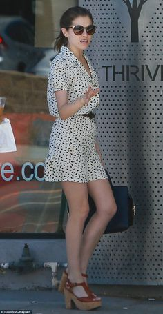 In top shape: The Twilight beauty looked alluring in a print mini dress with platform heel...
