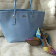 Coach zip top tote Beautiful coach bag gorgeous light blue color is 16 inches wide by 11 inches high used it twice beautiful lining matches inside plenty of pockets it is an authentic Coach bag Coach Bags Totes