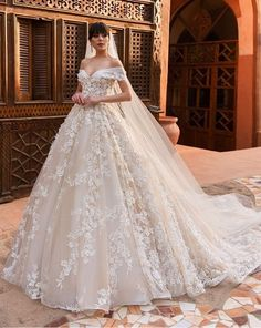 Looking for a regal ball gown? We have the largest collection at EVAS BRIDAL INTERNATIONAL