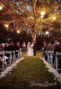 Love this picture... An outdoor wedding in the evening with lots of lights up in the trees <3