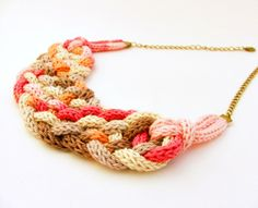 knitted braided necklace in orange, pink and beige colors