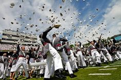 The U.S. Military Academy Class of 2011 takes part in the traditional hat toss after being dismissed by Army Brigadier General William E. Rapp, the Commandant of Cadets. The ceremony took place at the U.S. Military Academy at West Point, New York, on May 21, 2011. (Army photo by Tommy Gilligan)
