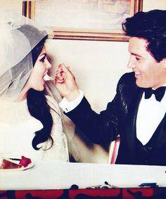 Elvis feeds his bride, Priscilla a piece of wedding cake, May 1, 1967.