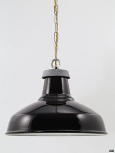 A black enamel lampshade. Made in Britain from two materials: steel and vitreous enamel. The quality of these black enamel light shades is unmistakable when you handle them. Shades of this type or pattern were ubiquitous in factories and workshops from the early 20th century. Although the shade is authentic in every respect, the pitch-black glossy enamel finish gives it a contemporary or designer feel.