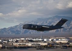 A U.S. Air Force C-17 Globemaster III takes off from Nellis Air Force Base, Nev. during the U.S. Air Force Weapons School's Joint Forcible Entry Exercise 14B Dec. 6, 2014. The C-17 is capable of rapid strategic delivery of troops and all types of cargo to main operating bases or directly to forward bases in the deployment area. (U.S. Air Force photo by Airman 1st Class Mikaley Towle)