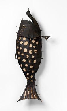 John Davis  Australia 1936–99  (Spotted fish)  1989  twigs, cotton thread, calico, bituminous paint  55.0 x 145.0 x 30.0 cm