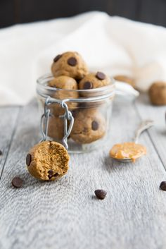 Healthy Protein-packed peanut butter balls that taste like a peanut butter cup. No sugar added, grain free, gluten free and over 5g protein per ball! | ambitiouskitchen.com