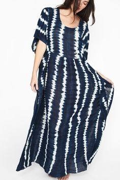 Indigo shibori dyed, flowy caftan by Proud Mary. Made with organic cotton voile, handwoven, dyed and sewn in Mali. - 100% Cotton - Made with locally harvested indigo in Mali, West Africa - One size fi