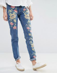 We've got 2 new hot denim trends to look out for this fall: embroidered  jeans (pretty sure Gucci's fall collection has something to do with it)and  asymmetrically-cut jean hems, sometimes made of different styles of denim  put together (also known as the Vetements-trend).