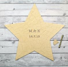 Star-shaped puzzle guest book for weddings or other events. Looks lovely with…