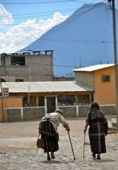 Elderly women leaving Mayan Families lunch program for trek home - from travel writer MICHELE PETERSON'S story of why she's now volunteering in Guatemala.