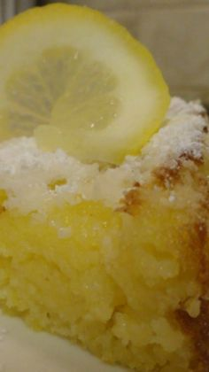 Lemon Ricotta Cake Recipe ~ The ricotta in this lemon cake gives it such a richness while still being kind of airy. It's almost like a fluffy pudding cake. The lemon is very refreshing.