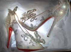 Christain Louboutin's glass slippers are made of lace but still have his trademark red sole.