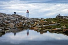 Peggy's Cove is a small rural community located on the eastern shore of St. Margarets Bay in Nova Scotia's Halifax Regional Municipality, which is famous for the Peggy's Point Lighthouse (established Countries To Visit, Places To Visit, Fish Hut, Frozen In Time, Newfoundland And Labrador, Atlantic Ocean, Nova Scotia, Natural Wonders, Regional