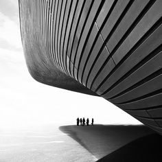 "dezeen: "" The undulating facade of Zaha Hadid's London Aquatic Centre captured by photographer Luke Hayes in silver gelatine London Architecture, Space Architecture, Amazing Architecture, Contemporary Architecture, Minimalist Architecture, Classical Architecture, Zaha Hadid Architects, Architects London, Modern Architecture"