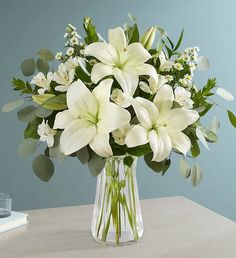 Striking lily bouquets add sophistication and timeless beauty to any occasion. Order lily flower arrangements for delivery featuring all varieties of lilies. Lilly Bouquet Wedding, White Lily Bouquet, White Lily Flower, Lilly Flower, Lily Wedding, White Flowers, Tiger Lily Bouquet, Stargazer Lily Bouquet, Lilies Flowers