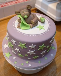 Shiny Rubbie People - lilac purple white and green baby shower cake with monkey and stars