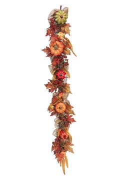 Hanging this mini pumpkin fall inspired garland from the fireplace.