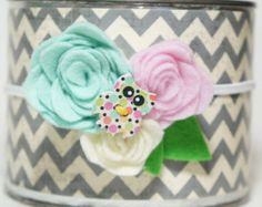 This headband has bright yellow and fuchsia felt flower roses with a little silver button and green felt leaves. Great for summer and spring days!