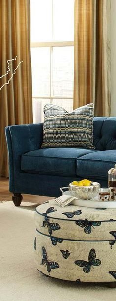 A blue sofa always makes a living room look more stylish and inviting. #blue #sofa #livingroom #stylish #inviting