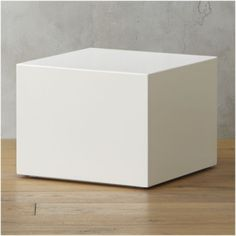 """[$199] Shop city slicker white side table.   Spiffy cube in hi-gloss lacquer reflects light and color.  Just 14"""" high with a hint of reveal off the floor.  Think side table, nightstand, multiples bunched to coffee table."""