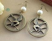 The Hunger Games Logo with peeta pearl pendant ,Inspired Mockingjay Earring