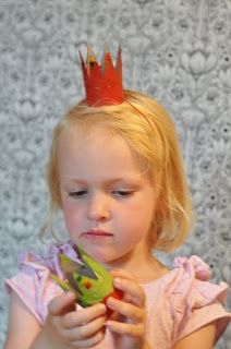 cut out crowns from toilet paper rolls...have the little ones paint them at the party!!! (on second thought maybe the birthday girl could paint them before the main event...less mess:)