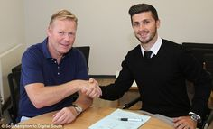 Shake on it: Ronald Koeman and Shane Long are all smiles after agreeing the deal...