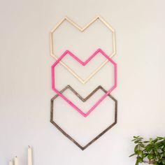 This graphic, modern DIY wall art idea is perfect for a hip nursery, bedroom or as wedding or Valentine's Day decor. Make it for $5! Click for free template.