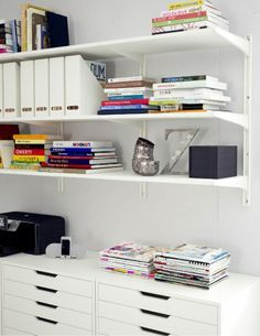 White shelves and drawers from Ikea.