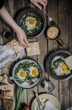 Baked eggs with feta and pine nuts