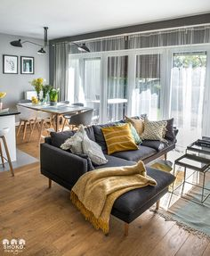Living room with summer vibe (see more) #poland #apartment #design #interior #decor #home #white #yellow #island #lighting #Lamp #hanging #wood #chairs #bar #dining #table #zone #area #cushions #throw #textile #floor