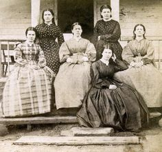 The 'Hawkins Girls, Who Saw Sights' pose soon after the Civil War on a porch at their family farm amid Spotsylvania County's Chancellorsville battlefield. Their relations still live in the area