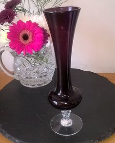 $10.68 - Beautiful example of an Amethyst Glass Vase.  Excellent condition Approx 8 inches high and 2 inches diameter across the top.  Lovely twisted stem detail - as pictured  Thank you for looking and please do not hesitate to ask questions about any of my items.  Items posted within the UK are sent by 2nd class mail  USA postage is by Royal Mail International Standard Please check my policies before ordering - thank you