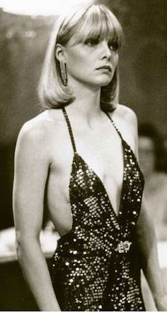 Michelle Pfeiffer, Scarface An update on the classic gangster moll, Michelle Pfeiffer's spaghetti-strap cami dresses in Scarface left little to the imagination. Clothes on Film has a great essay on the movie's fashion ethos: dress like the world is yours.