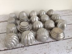 19 vintage Jello Molds in a variety of shapes.