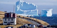 This enormous iceberg, one of the first of the season to float into 'iceberg alley,' has turned the small town of Ferryland into a sudden tourist spot. Photo / Jody Martin