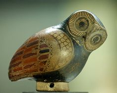 Protocorinthian aryballos (perfume pot) in the shape of an owl. Opening in the tail, hole in the basis to suspend by a lace.  From Greece.Artist unknown; ca. 640 BCE.  Now in the Louvre...