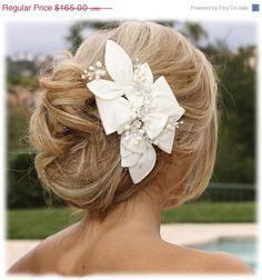 Bridal fascinator, Bridal headpiece, Handmade pearl Rhinestone hair pin, Wedding hair accessory, bridesmaid headpiece. $115.50, via Etsy.