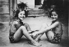 Twin sisters Yehudit and Lea pose together holding hands in their bathing suits. Mengele twins.