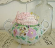 I love teapots...short and stout.  Love this pincushion.